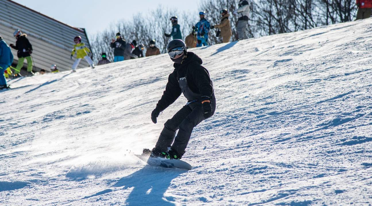 a person on the top of a ski slope